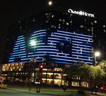 Windows of the Omni Hotel in Dallas lit in an arrangement to create the ASCE logo