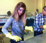 The 10 students selected as this year's New Faces of Civil Engineering—College Edition achieved academic success and made a commitment to community involvement. Racheal Cooley, a student at University of South Alabama and a member of the school's Concrete Canoe team helps place the concrete for her school's canoe for the Concrete Canoe Competition at the ASCE Southeast Regional Conference. Photo Credit: Racheal Cooley