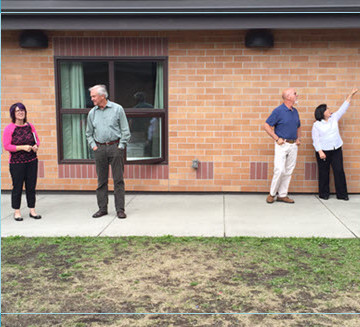 The project team tours McKinnell House as part of an information-gathering session.
