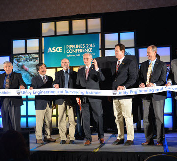 ASCE President Bob Stevens prepares to cut the UESI ribbon, signifyinig the launch of the new Institute. Photo: Tenzing Barshee