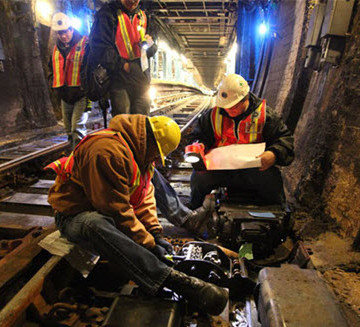 Transit authority teams replace a train switch in a subway tunnel damaged by Hurricane Sandy floodwaters. A short course at the ASCE 2015 Convention explores New York's response to Sandy and emergency preparedness overall.
