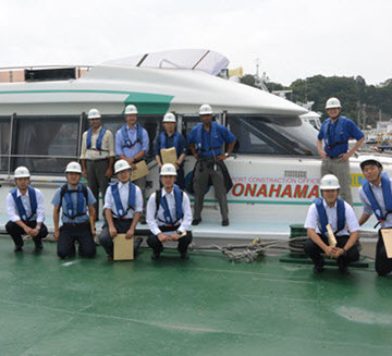 The COPRI-PARI Port Investigation Team at the Port of Onahama. The waterside tour included observation of breakwaters, seawalls, quaywalls, and construction of a major bridge linking a new coal terminal to the mainland. PHOTO: PARI