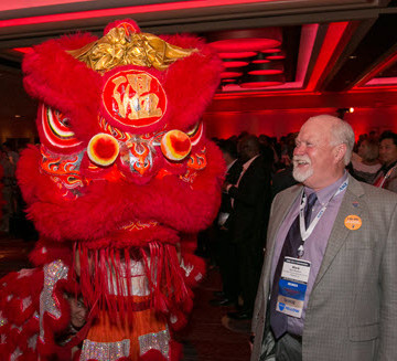 Mark Woodson, ASCE 2015 President-Elect, takes in the dragon dance show at the welcome reception at the ASCE 2015 Convention. PHOTO: David Hathcox for ASCE