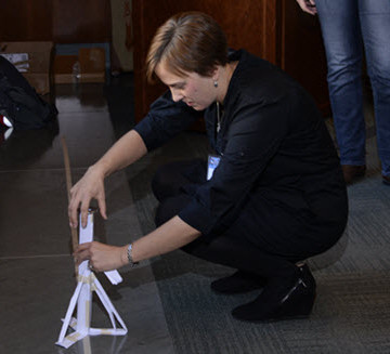 Chantal Hayes, of the Cincinnati Museum Center, sets up her group's structure for its wind test. PHOTO: John Eric Dove