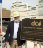 Longtime ASCE member and award-winning wastewater treatment  leader and innovator Walt Bailey stands with the plaque announcing the new DC Water facility as his namesake.