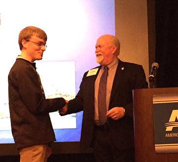 ASCE President Mark Woodson congratulates Nathan Shellhamer on winning the Dream Big Contest grand prize.