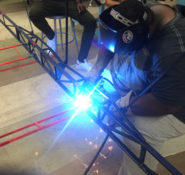 Gary Wallace Jr. works with the Morgan State steel bridge team.