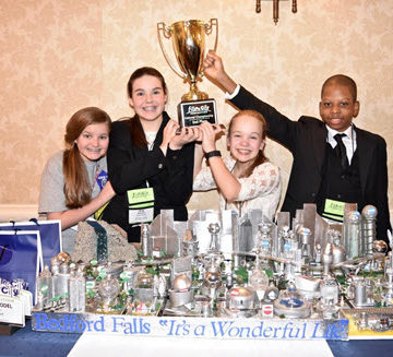 The Harbor View Academy team of, from left, Sarah Grace Seggerson, Joy Mitchell, Lucy Metheny, and Joshua Richardson, celebrates its award.