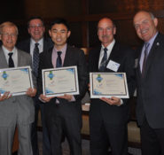 The team behind the Ocean Forest submittal that won the Innovation Contest's Overall Best New Concept receive their award from Jerry Buckwalter and Terry Neimeyer.