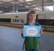 Nathan Shellhamer 'dreams big' in front of a bullet train.