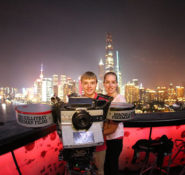 Nathan Shellhamer and Monica Isza stands between the MacGillivray Freeman Films camera and the Shanghai skyline during his visit to a Dream Big film shoot. PHOTO:  Marc Ostrick