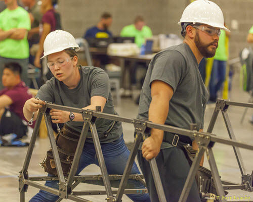 George Mason University students assemble their bridge at the 2016 competition. PHOTO: T. Bart Quimby
