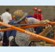 The University of Tennessee works to assemble its steel bridge at the 2016 national competition. PHOTO: T. Bart Quimby