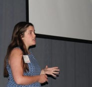 Morgan DiCarlo presents her innovative idea for water conservation to an audience at Walt Disney Imagineering.