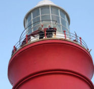 President Mark Woodson and Executive Director Tom Smith stand atop the newly dedicated international historic landmark Cape Agulhas Lighthouse in South Africa.