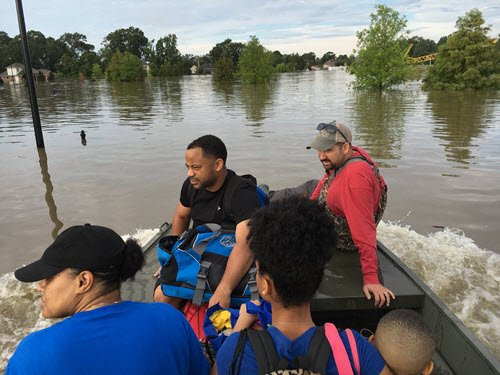 Joey Coco takes Baton Rouge residents from their homes by boat to the nearest safe shelter. PHOTO: Joey Coco