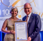 Therese Kline, flexible pipe specialist in the special structures unit of Highway Development and president of the Michigan Section of ASCE, receives the State of Michigan recognition for the Michigan Section of ASCE's 100 years of service from Director Steudle. PHOTO: Michigan ASCE