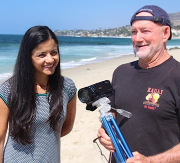 Dream Big Contest winner Rocio Rodriguez, P.E., M.ASCE, hangs out with the film's director Greg MacGillivray on Laguna Beach. PHOTO: Barbara MacGillivray