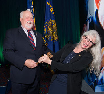 2017 ASCE President Norma Jean Mattei playfully wrests the ceremonial gavel from 2016 President Mark Woodson.  Photo by Jim Tkatch for ASCE