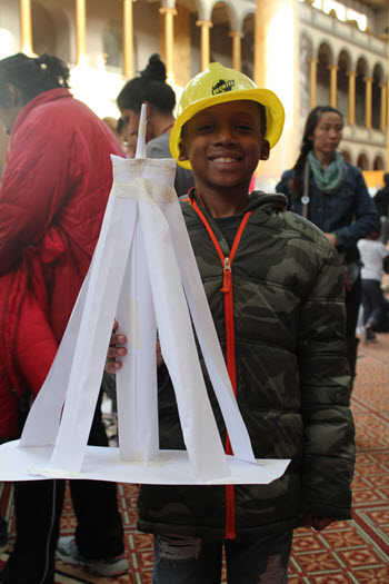 Davian Booker shows off the tower he designed and constructed at Engineering Family Day.