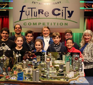 ASCE President Norma Jean Mattei, back right, joins the winning team from Austin (TX) West Ridge Middle School at the Future City Competition finals.