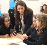 Dream Big featured civil engineer Menzer Pehlivan works with girls from St. Theresa School - from left, Isabelle Mascarenhas, Emily Frost, and Breda Brosey.