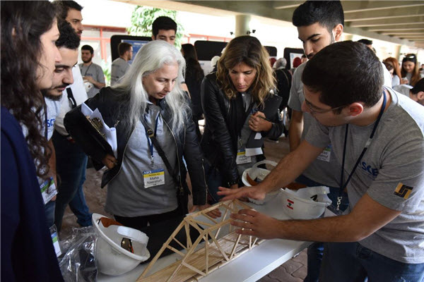 PHOTO: Lebanon Section The technical jury considers a popsicle bridge during a recent student competition hosted by the Lebanon Section.