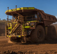 A Cat 793F CMD mining truck leaves an iron ore pit. PHOTO: Mark Sprouls/Caterpillar