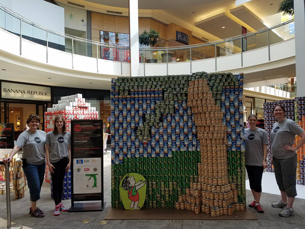Members of the Pittsburgh YMF stand proudly with their Canstruction creation. PHOTO: Pittsburgh YMF