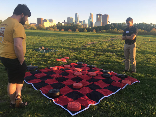 The Minnesota YMG takes its yard checkers very seriously. PHOTO: Ariel Christenson