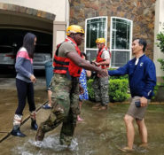 National Guardsman shakes hands with a  Houston homeowner whose house was flooded by Hurricane Harvey. PHOTO: U.S. Dept. of Defense