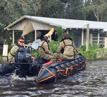 Soldiers with the Florida Army National Guard's 20th Special Forces Group go door-to-door in the Jacksonville area near Ortega Island, performing search-and-rescue missions in the aftermath of Hurricane Irma. PHOTO: Dept. of Defense