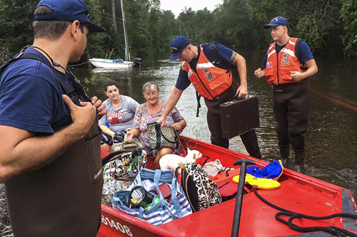Coast Guardsmen conduct rescue operations in Jacksonville. PHOTO: Dept. of Defense