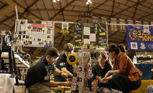 Engineer Angelica Hernandez mentors students from her former Phoenix high school as they prepare to enter a robotics contest. ASCE members can help bring the Dream Big film into schools in 2018.